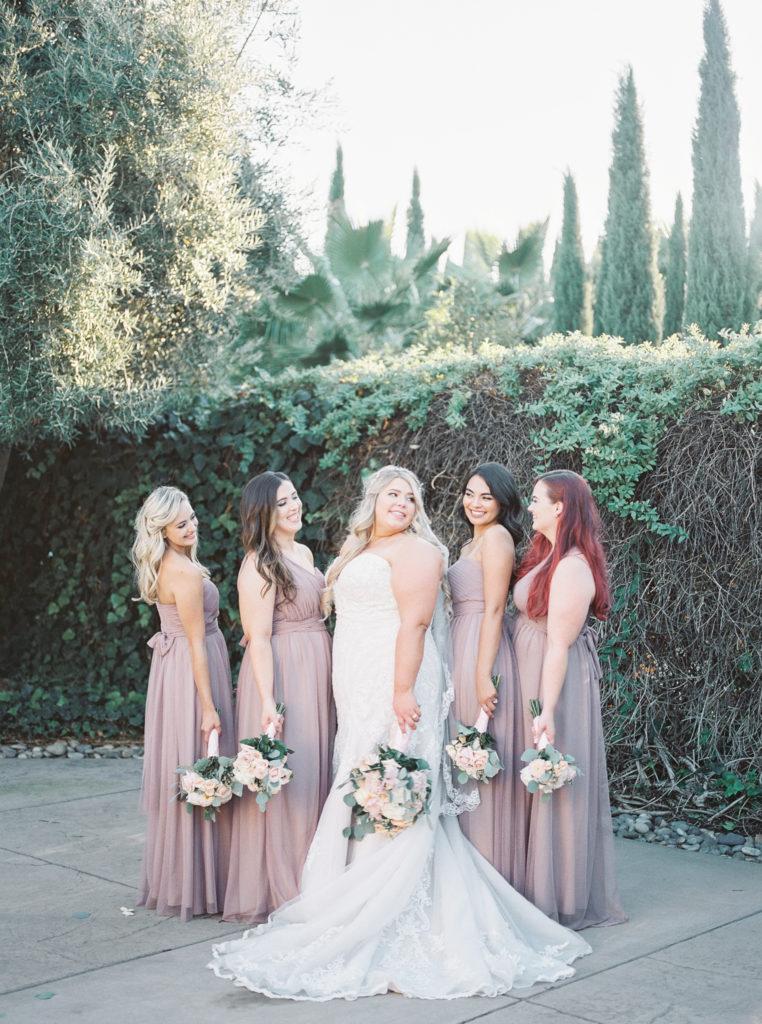 bridesmaids and bride posing during intimate estate wedding photos
