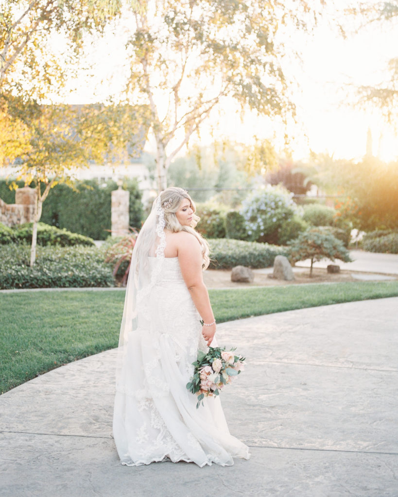 bride walks the grounds of her intimate estate wedding