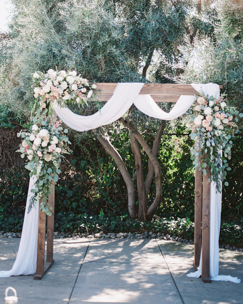 beautiful handmade archway at an intimate estate wedding