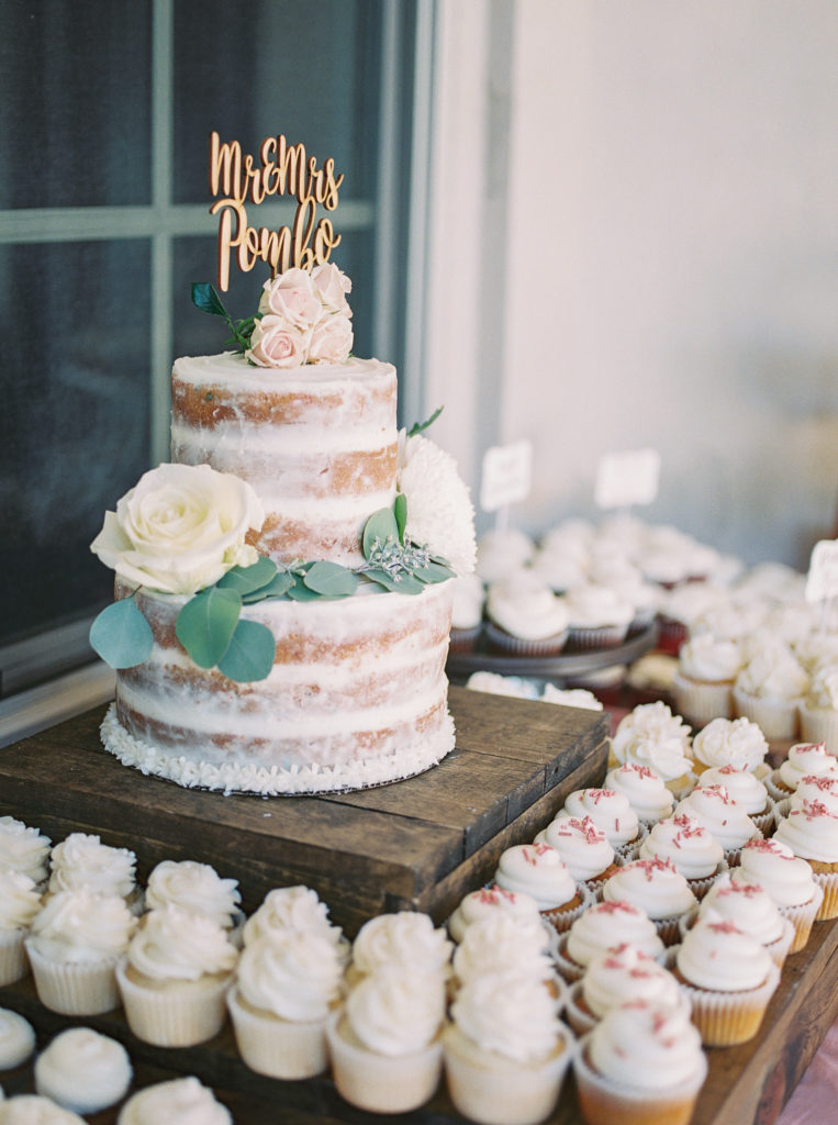 naked dusted cake and cupcakes at an intimate estate wedding