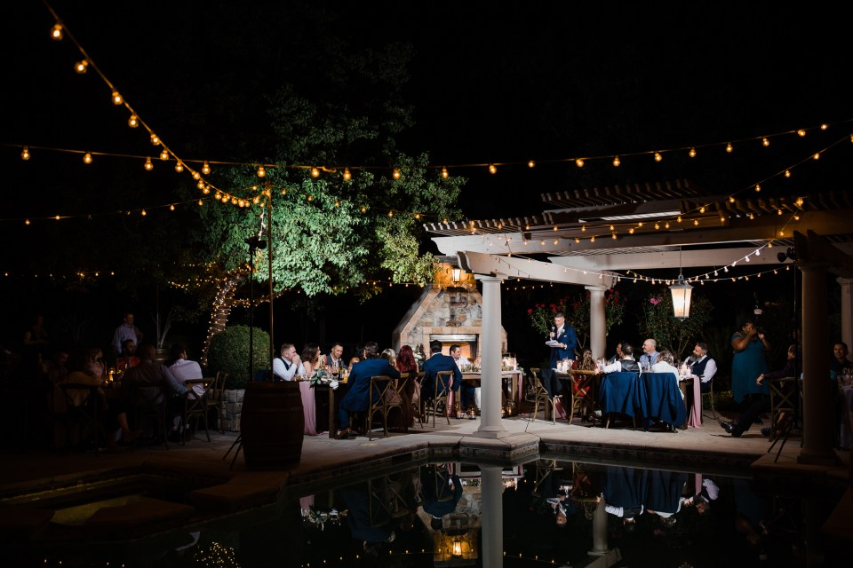 nighttime photo of an intimate estate wedding reception