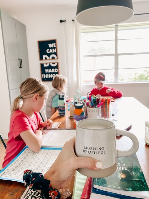 mom and kids working on best homeschooling tips