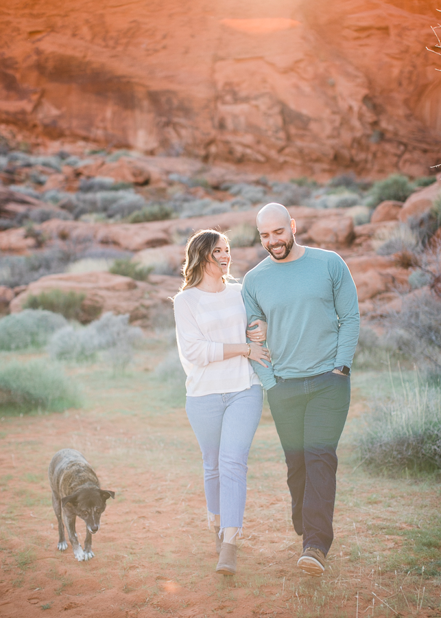 a couple walking with their dog during Valley of Fire engagement session