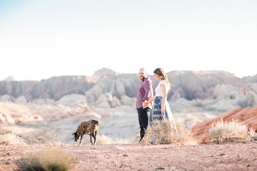 a couple plays with their dog during Valley of Fire engagement session