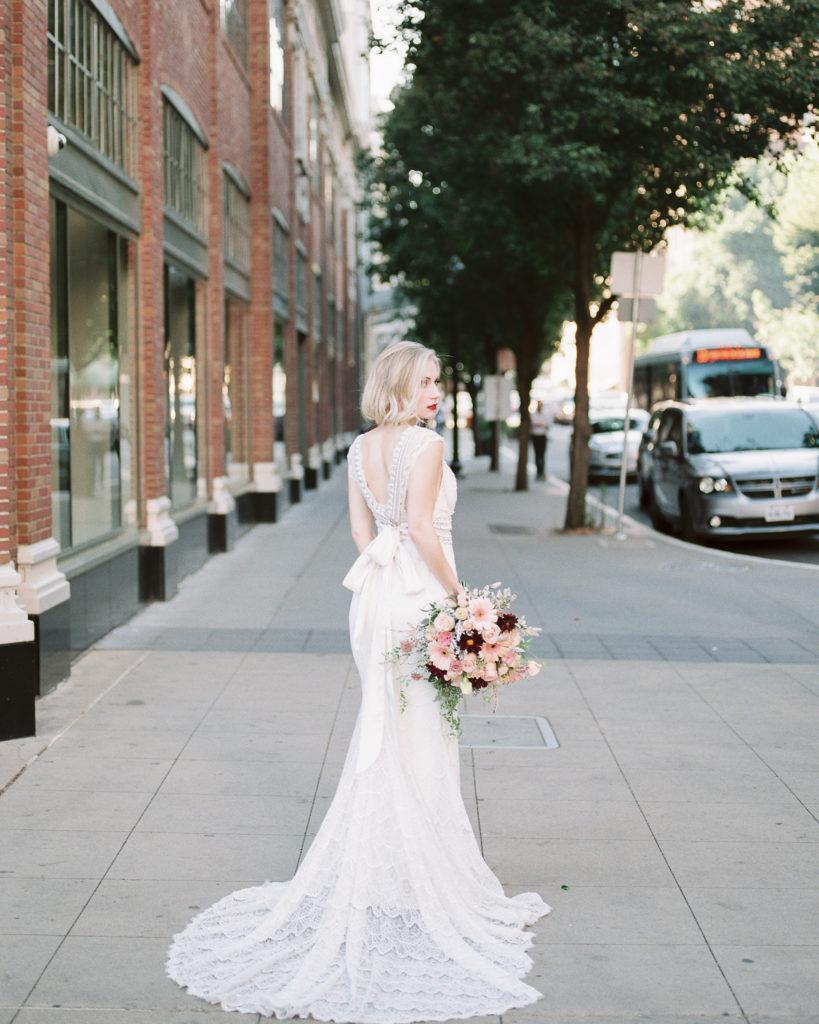 bride in the street posing for wedding photos