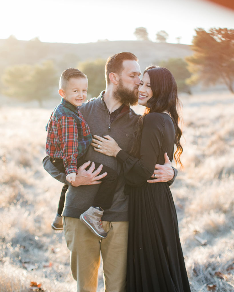 a family laughs together during family photos at Santa Teresa Park