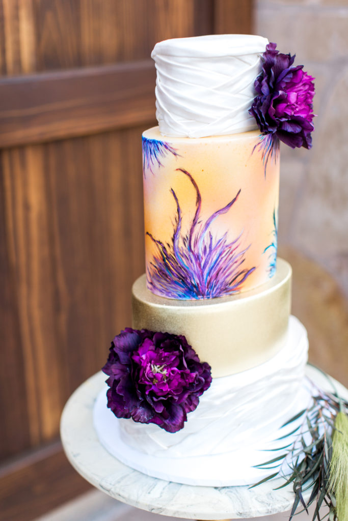 purple themed wedding cake by Above & Beyond Bakery