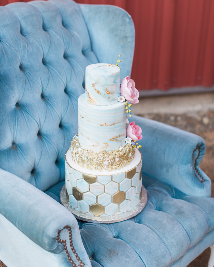 a beautiful gold leaf themed wedding cake by Ettore Bakery