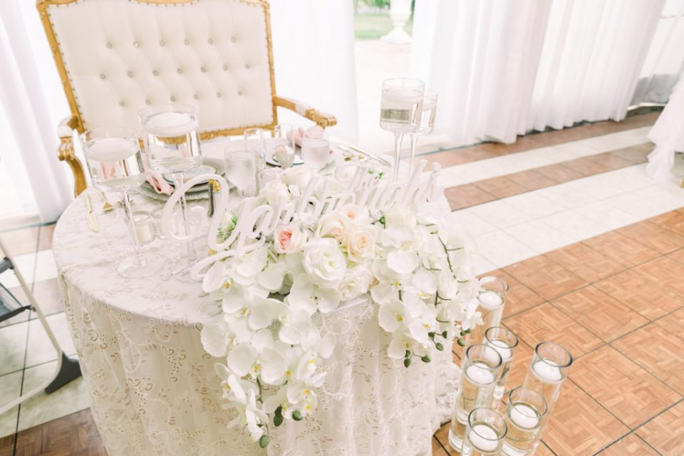 sweetheart table covered in orchids and flowers at a Grand Island Mansion wedding