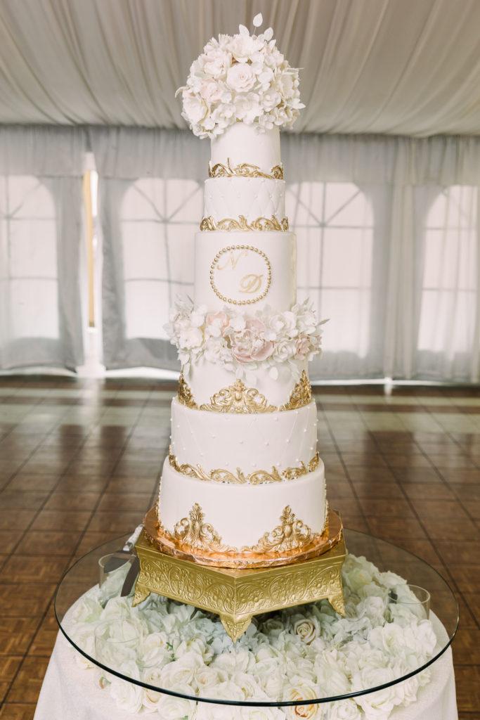 a 6-tiered wedding cake at a fairytale Grand Island Mansion wedding