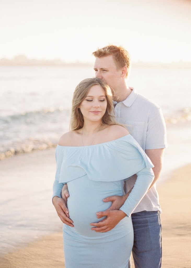 beach maternity photos during golden hour
