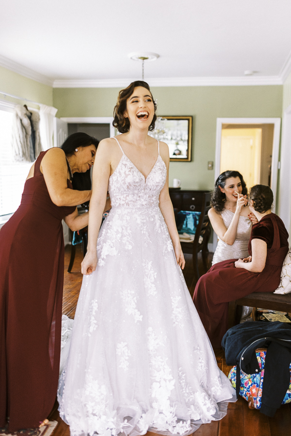 a bride gets dressed for her Bay Area intimate wedding