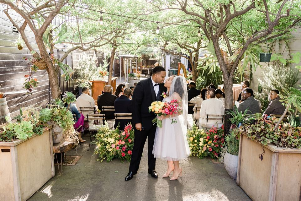 a bride and groom kiss at Stable Cafe in San Francisco