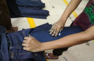 hand scraping blue jeans