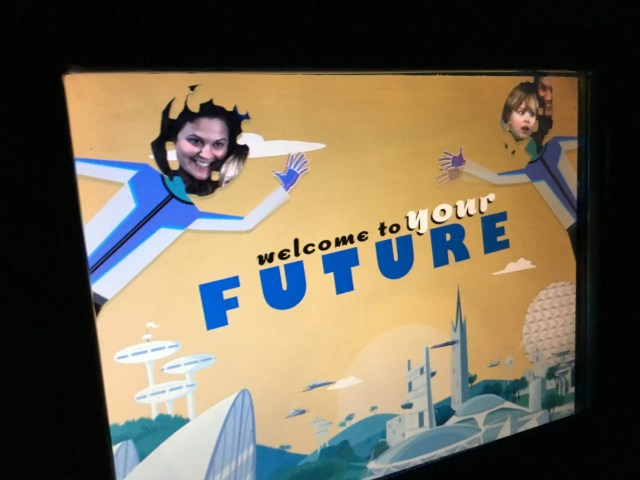 Welcome to your Future on yellow futuristic background with two cartoon figures with adult woman and boy child heads