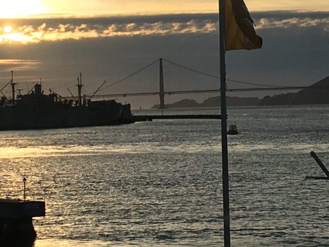 bridge and water glowing off water in golden hour san francisco