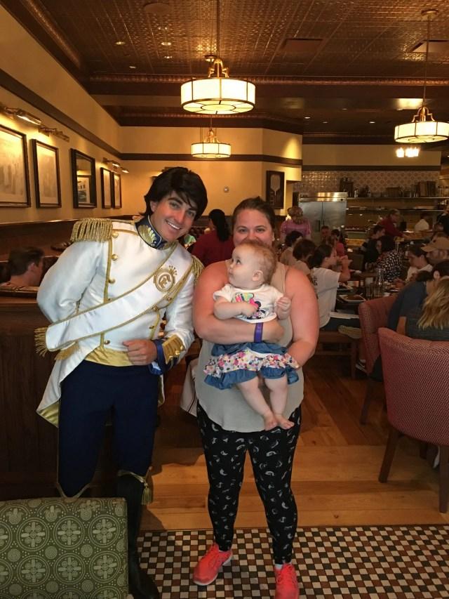 Prince Eric, woman and baby at Trattoria al Forno: Walt Disney World's Bon Voyage Breakfast