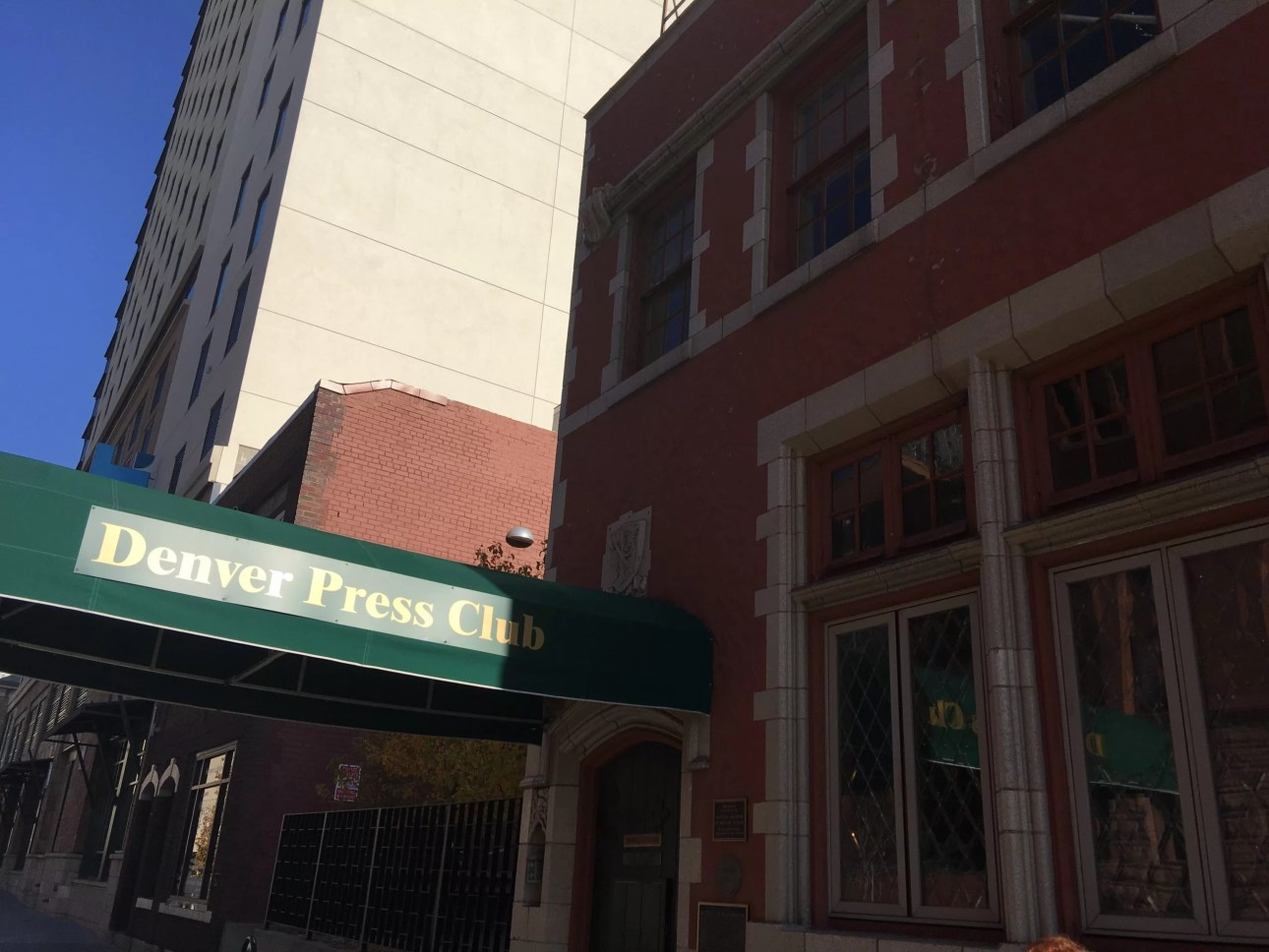 Green canopy at entrance of Denver Press club