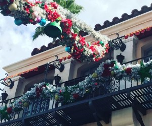 Boughs of evergreen over Hollywood studios' Sunset Boulevard for Christmas in Disney World