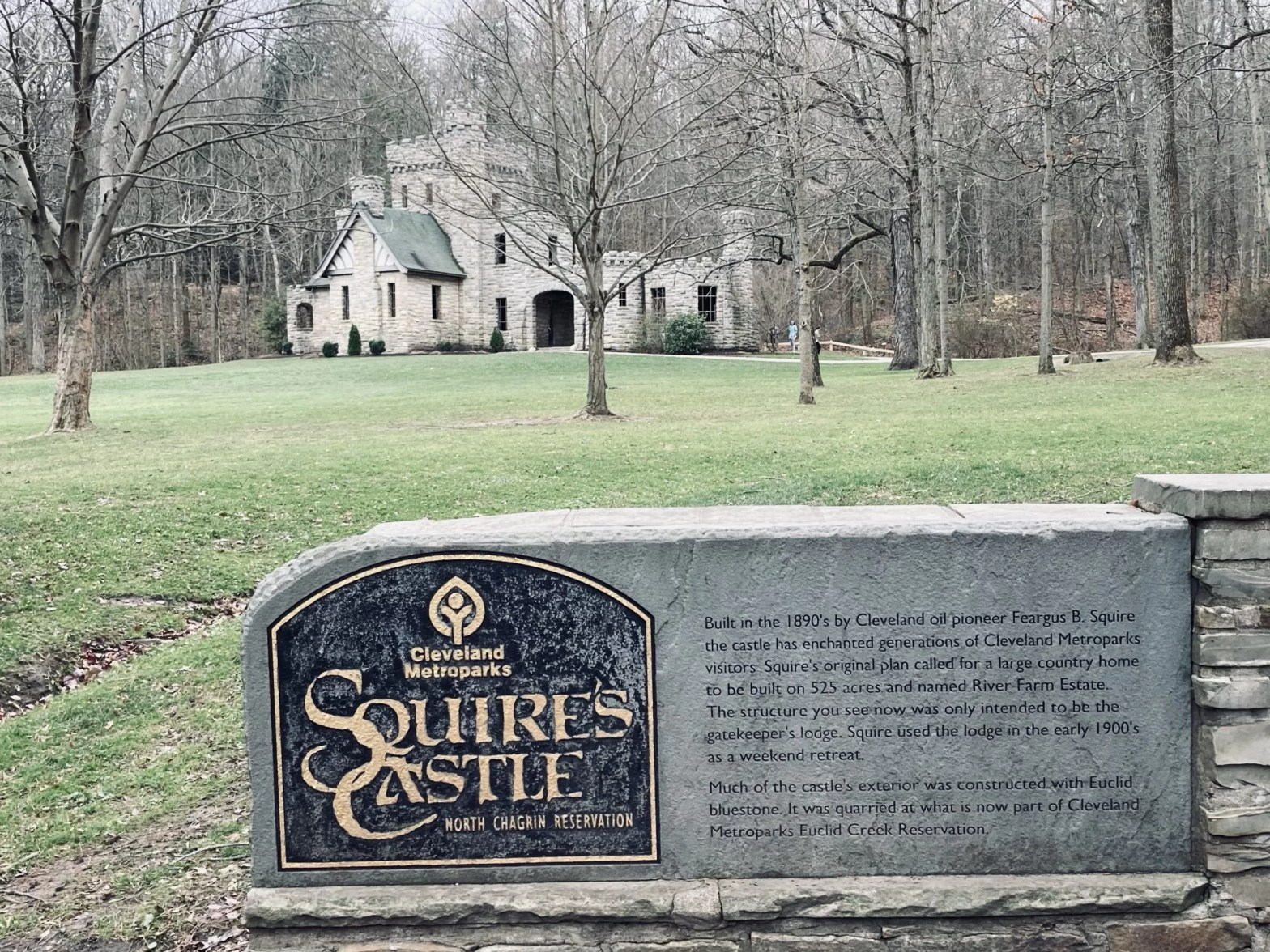 Squire's Castle with sign in the front and the gray castle in the background