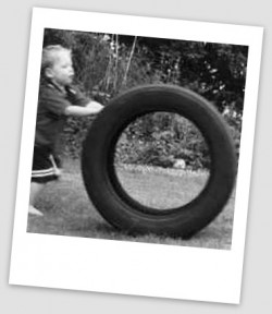 Boy running with tyre