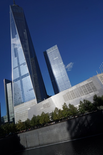 View of the new One World Trade Centre from the base of the Twin Towers memorial