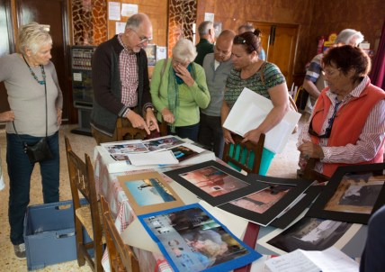 Photo group members discuss printing quality, sizes and mounting options in view of the upcoming show in May