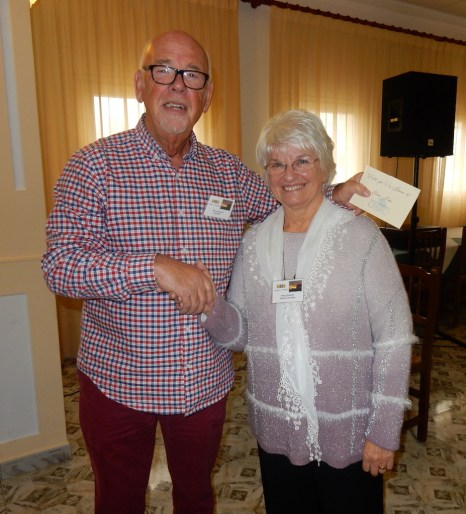 U3A President, John Hopwood makes presentation to Marg Roberts was a presentation to her of a voucher to her favourite restaurant in recognition of the years she has spent as Secretary and Assistant Secretary ever since Moraira – Teulada U3A was first established