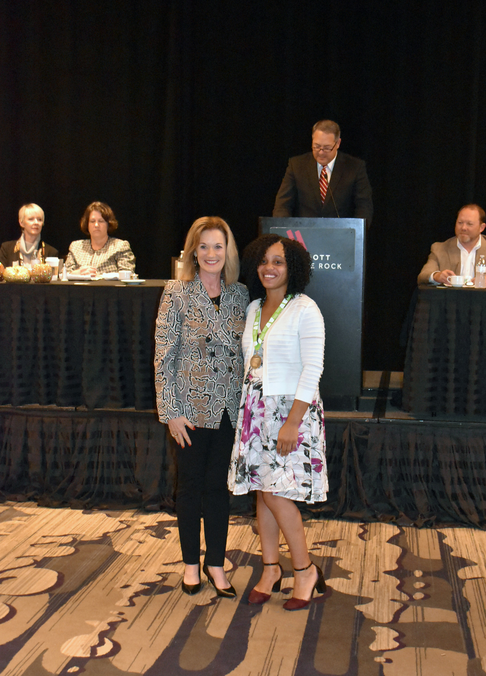 Pictured left to right: Dr. Sandra Massey, Chair of Arkansas Community Colleges President's and Chancellor's Committee, presents Kalesha Parrish with the UAHT Academic All-Star Award.