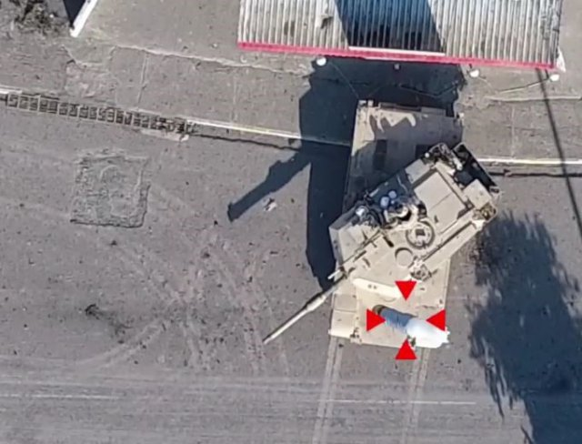 Screen capture from Islamic State video showing a drone munition drop targeting a tank