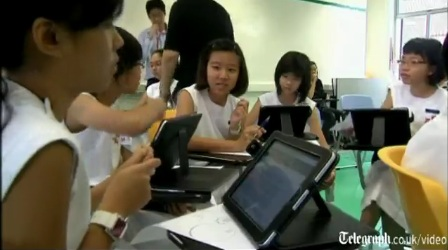 Students from Nanyang Girls High School using Ipads