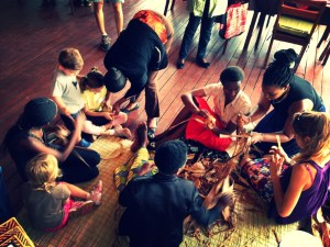 Artisans teach kids how to make traditional Rwandan crafts