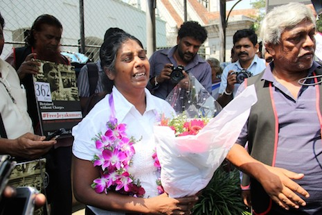 <p>Tamil rights activist Balendran Jeyakumari (center) stands with supporters after being released on bail yesterday (Credit: ucanews.com) </p>