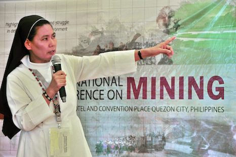 <p>Sister Stella Matutina explains the threats of large-scale mining in Mindanao during a conference in Manila in early August. (Photo by Leon Dulce)</p>