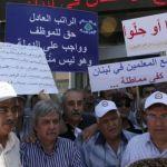 اعضاء هيئة التنسيق النقابية في مقدمة التظاهرة