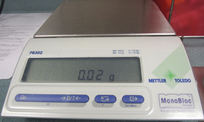 A scale is used to weigh cannabis before it is put in the vaporizer to ensure ac