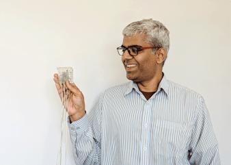 Gopala Anumanchipalli holding electrode.