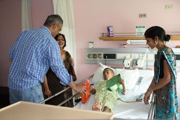 Rajdeep Sardesai along with Tulika ( Co Founder of Uday Foundation) giving gifts to little angels