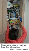 Rosemarie uses a reacher to access items in her pantry