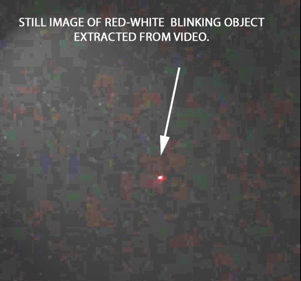STILL IMAGE OF RED-WHITE BLINKING OBJECT EXTRACTED FROM VIDEO.