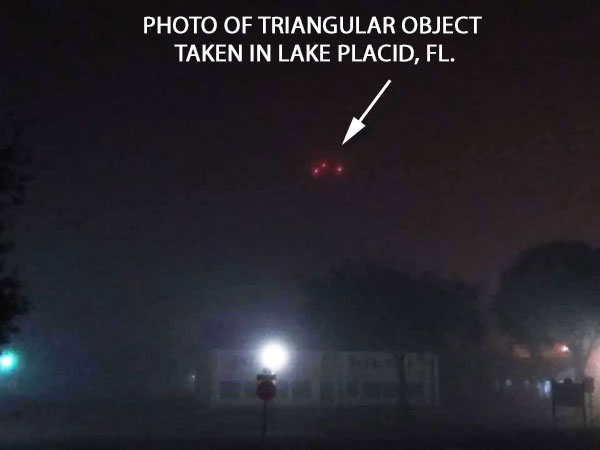 ONE OF PHOTOS OF TRIANGULAR OBJECT.