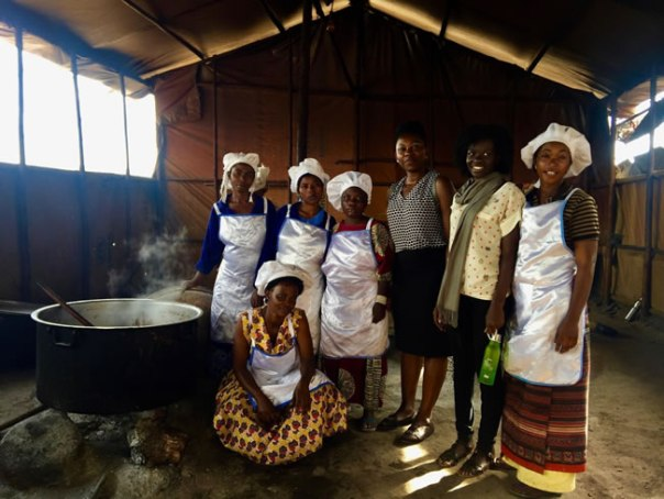 Anna (third from right) and Faith Atim, Refugee Reception Center Assistant, with the cooks at the refugee reception center, Kyaka II