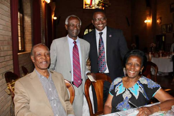 John and Christine Kiganda, long-time UCU supporters, pose at an October Friends of UCU event with Justice James Manage Ogoola, left standing, and UCU Deputy Vice Chancellor/Development and External Relations, David Mugawe.