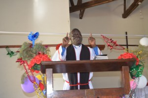 Rev. Canon Francis Willy Odora, delivering a message at St. Phillip's Cathedral in Gulu