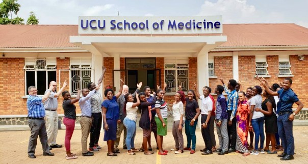 Doug Fountain (left) with some of the UCU School of Medicine of students in Mengo, Uganda. (UCUPartners' Photo)