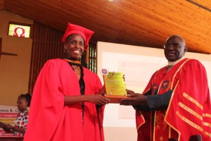 Prof. Monica Chibita (left) receives an award from Uganda Christian University Vice Chancellor, Rev. Canon Dr. John Senyonyi, shortly after her professorial inaugural lecture