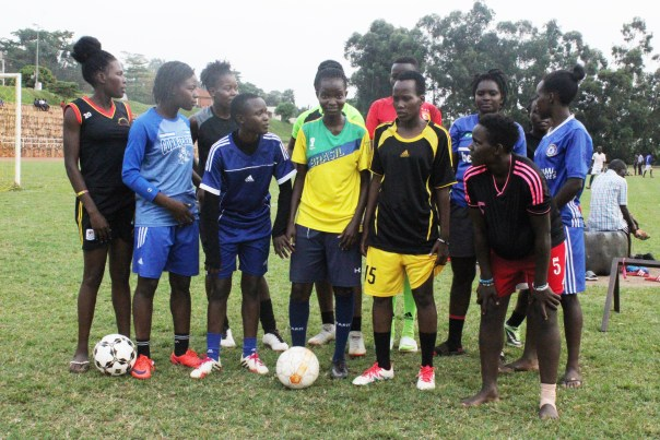 Akao (in yellow, center) poses with her teammates (Photo by Andrew Bugembe)