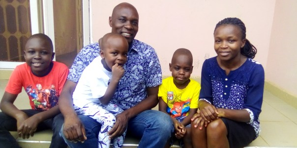 Frank Obonyo holds Keren, his daughter, who he features in the article. Other family members are the writer's wife, Cathryn, and children, Adonai and Ezekiel.