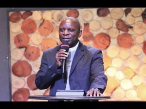 Eng Rev. Paul Wasswa preaches at a seminar