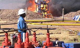TOTAL BUYS TULLOW INTERESTS IN ONE OF UGANDA'S MAJOR OIL DEALS